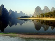The hills' reflections in the Li River are beautiful when look from afar